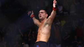 Middleweight Chris Weidman celebrates after defeating Kelvin Gastelum
