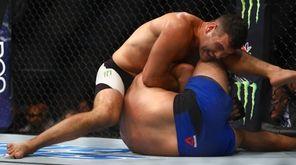 Middleweights Chris Weidman and Kelvin Gastelum fight during
