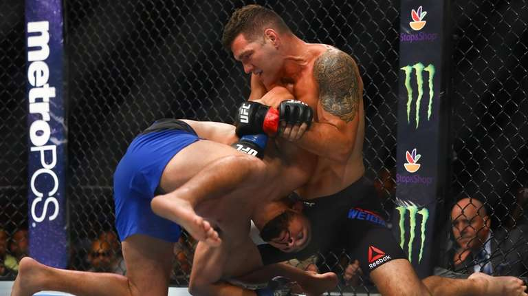 Middleweights Chris Weidman and Kelvin Gastelum fight during