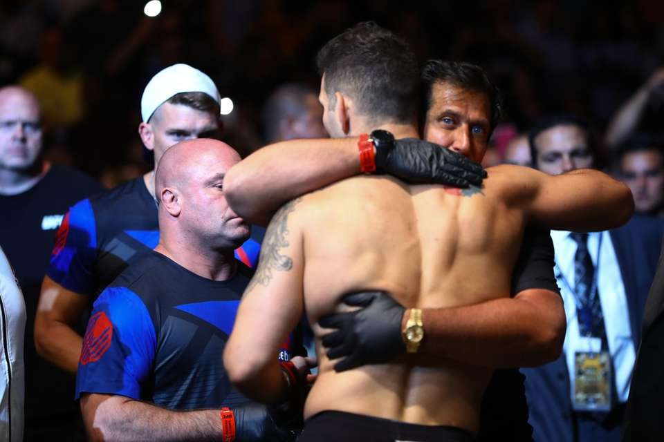 Middleweight Chris Weidman hugs trainer Ray Longo before