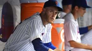 Mets pitcher Zack Wheeler looks on from the