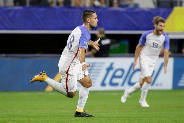 United States' Clint Dempsey, left, celebrates after scoring
