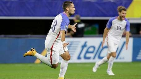 United States' Clint Dempsey, left, celebrates after scoring