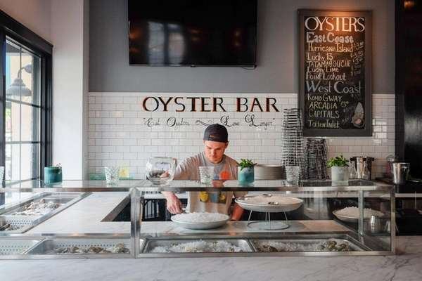 Peter Wills shucks oysters at the oyster bar
