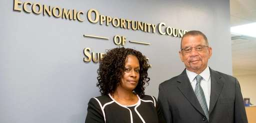 Adrian Fassett, right, and Songhi Scott, president and