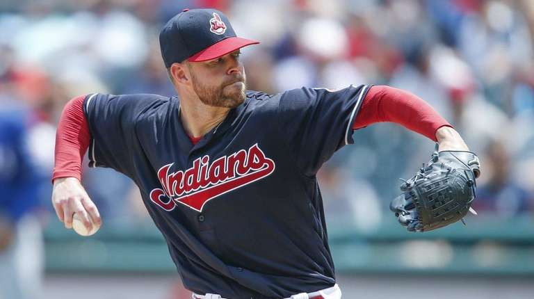 Corey Kluber of the Cleveland Indians pitches against