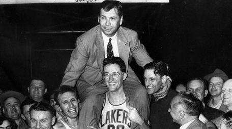Kundla, who led the Minneapolis Lakers to five