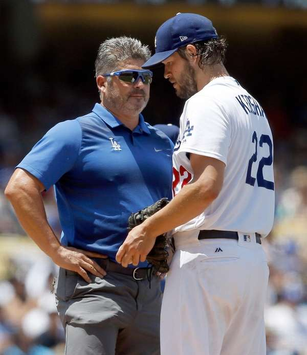 Los Angeles Dodgers starting pitcher Clayton Kershaw, right,