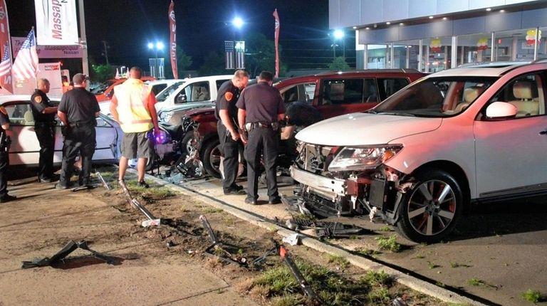 A car crashed into an auto dealership parking