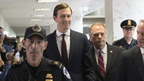 White House senior adviser Jared Kushner, center, accompanied