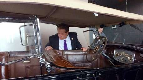 Gov. Andrew M. Cuomo looks inside the Packard