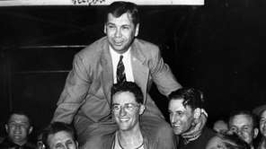 Basketball Hall of Fame coach John Kundla died