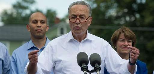 Senate Minority Leader Chuck Schumer of N.Y., accompanied