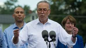 Senate Minority Leader Chuck Schumer of N.Y., accompanied