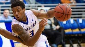 Hofstra guard Justin Wright-Foreman  drives on Charleston Cougars