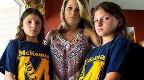 From left, Ava LaCalandra, 10, mother Jennifer LaCalandra,