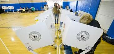 A Mattituck voter casts ballot during the April