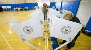 A Mattituck voter casts ballot during the April