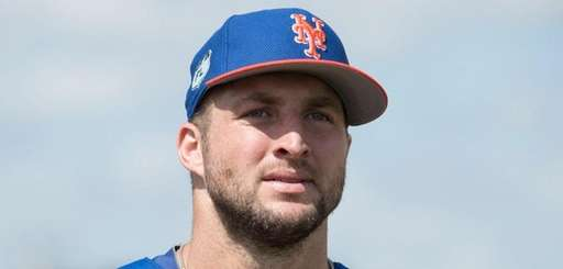 Mets outfielder Tim Tebow looks on during a