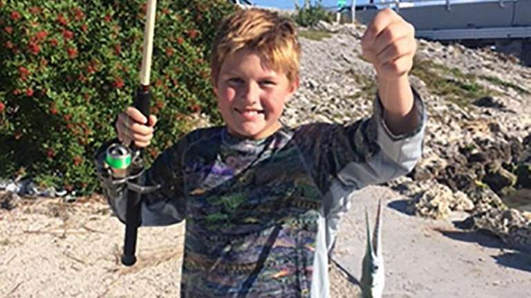 Kidsday reporter Jack Stam with a fish he