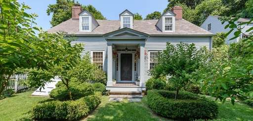 The three-bedroom, 2½-bath restored Colonial is set on