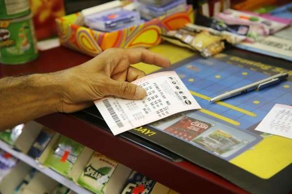 A customer buys a Powerball ticket, Thursday, June