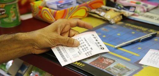 A customer buys a Powerball ticket, Thursday, June