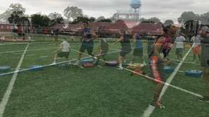Carey varsity football players practiced footwork and offensive