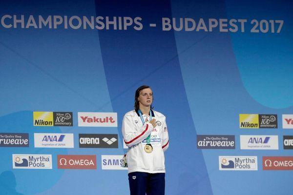 United States' gold medal winner Katie Ledecky listens