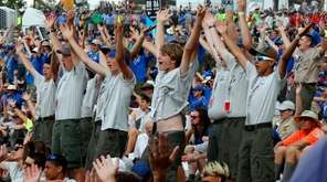 Boy Scouts sing and dance to music as