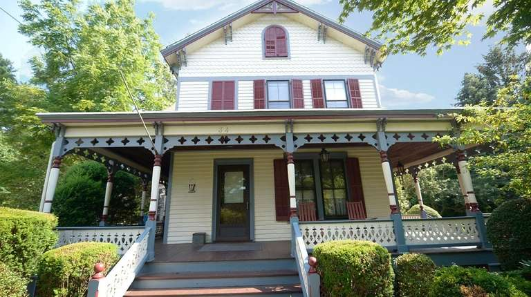 The circa-1890 home has intricate woodworking, original tri-color