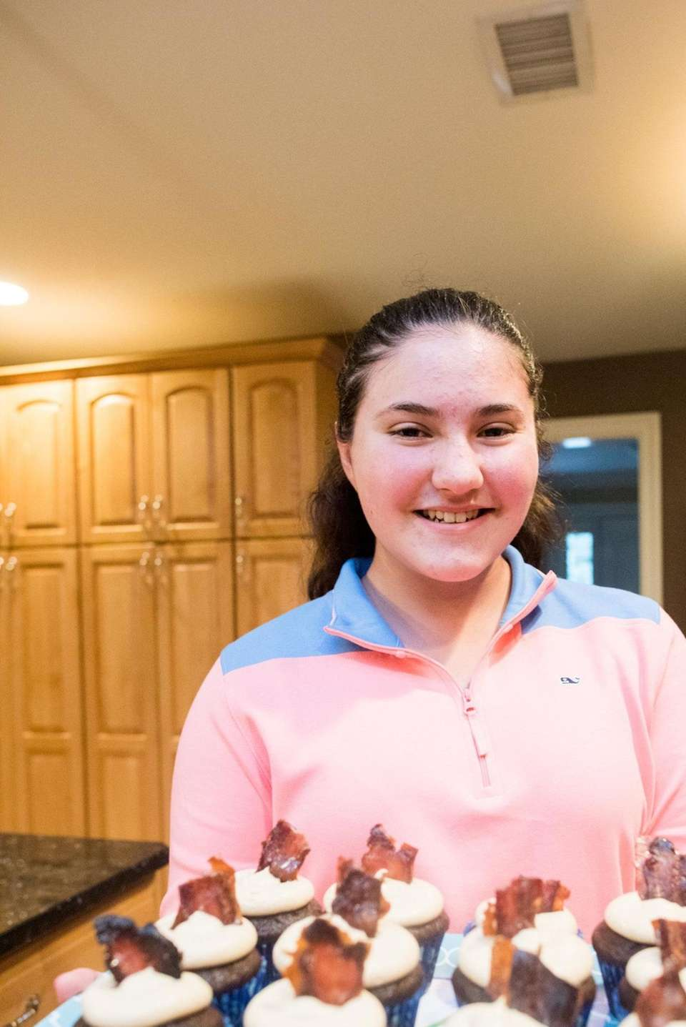 Ally Kustera, 13, shows off her candied bacon