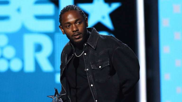 Kendrick Lamar accepts the award for best male