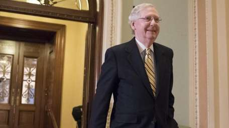 Senate Majority Leader Mitch McConnell, R-Ky. walks from