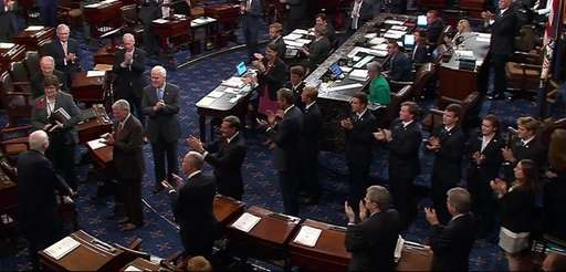 Senator John McCain arrived in the Senate Chamber