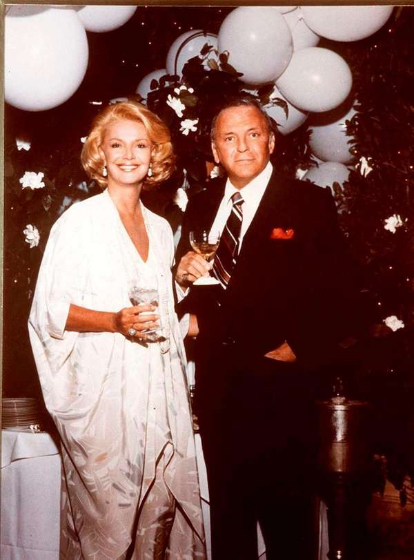 Barbara and Frank Sinatra at a party at