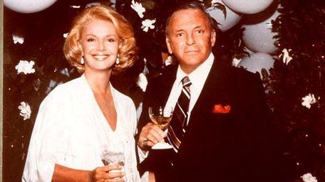 Barbara and Frank Sinatra at a party at