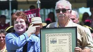 Billie Jean King presents former tennis star Mervyn