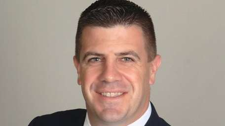 Brian Scheidel of Carle Place has been promoted