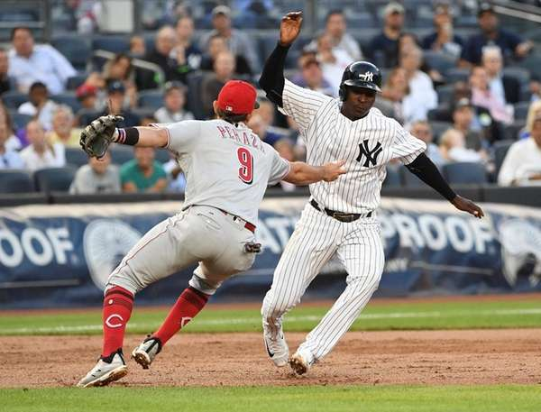Frazier's run-scoring triple play helps Yanks top Reds 4-2