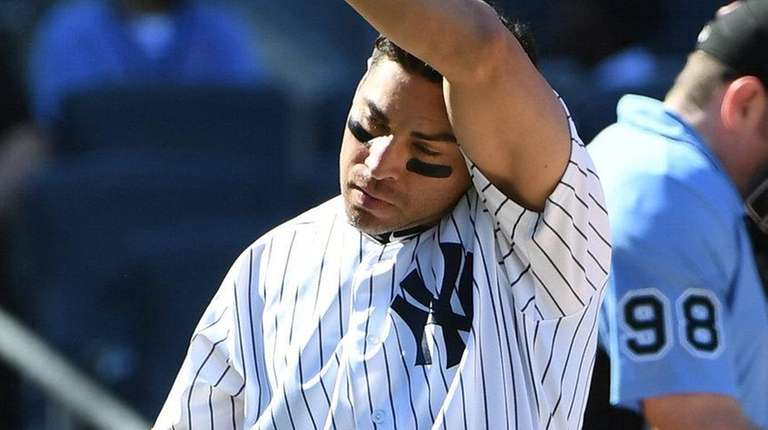 Yankees centerfielder Jacoby Ellsbury reacts against the Blue