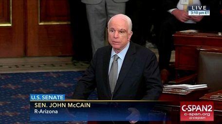 Sen. John McCain speaks before the Senate vote