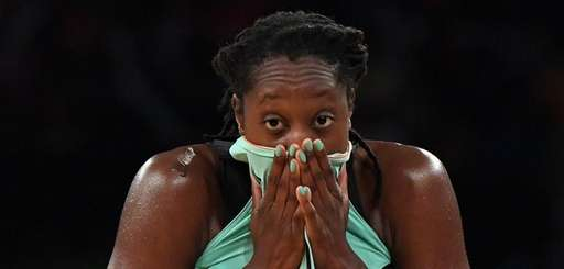 Liberty center Tina Charles wipes her face with