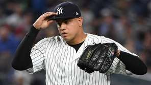 Yankees reliever Dellin Betances reacts against the Reds