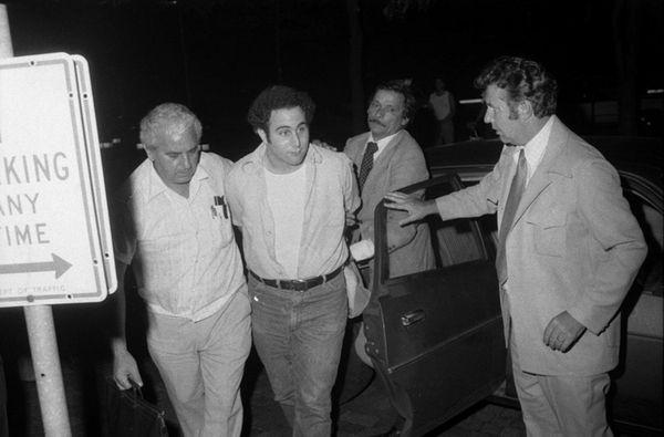 Police escort handcuffed Son of Sam suspect David
