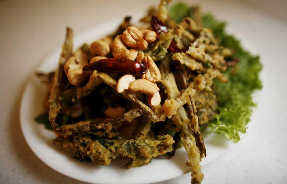 A crispy watercress salad is served at SriPraPhai