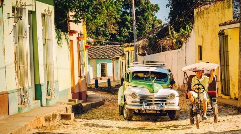 With vintage cars and rickshaws, Trinidad is a