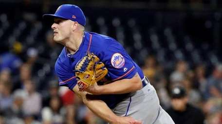 Mets closer Addison Reed works against a San