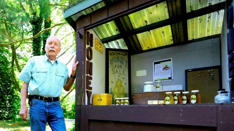 Richard Blohm, a master beekeeper in Huntington, stands
