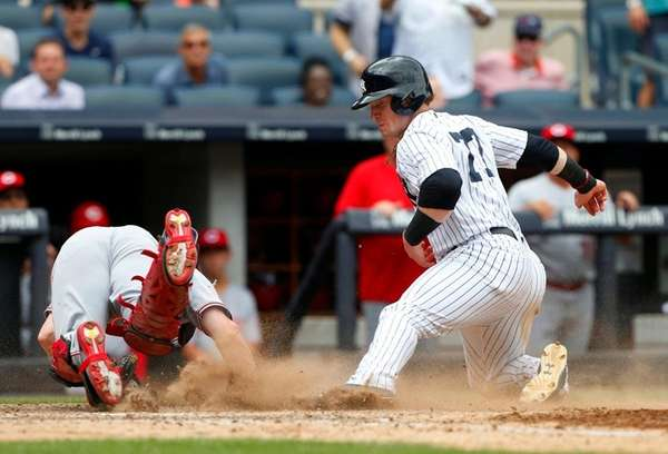 Rookie Clint Frazier of the Yankees scores against